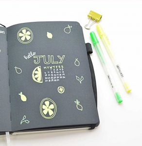 July Bullet Journal cover image with a mini calendar, lemon doodles, and a nice header!